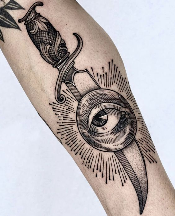 Tatuaggio Uomo Pugnale con Occhio - Tatuaggio Uomo Pugnale: Immagini e Significato